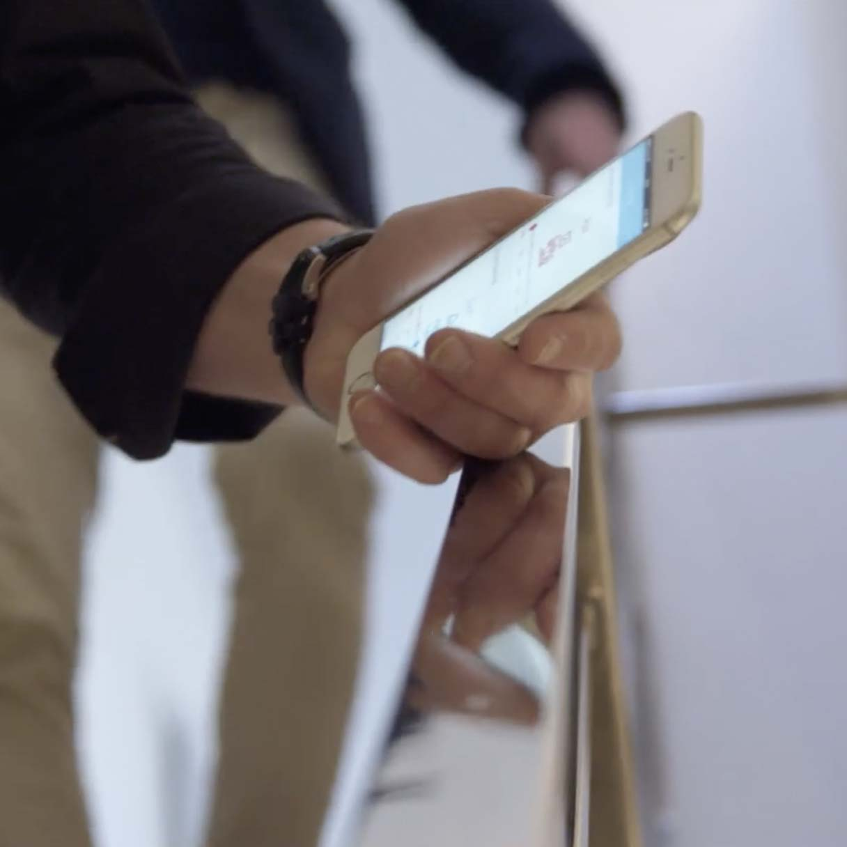 Man holding phone showing the SweepBright app